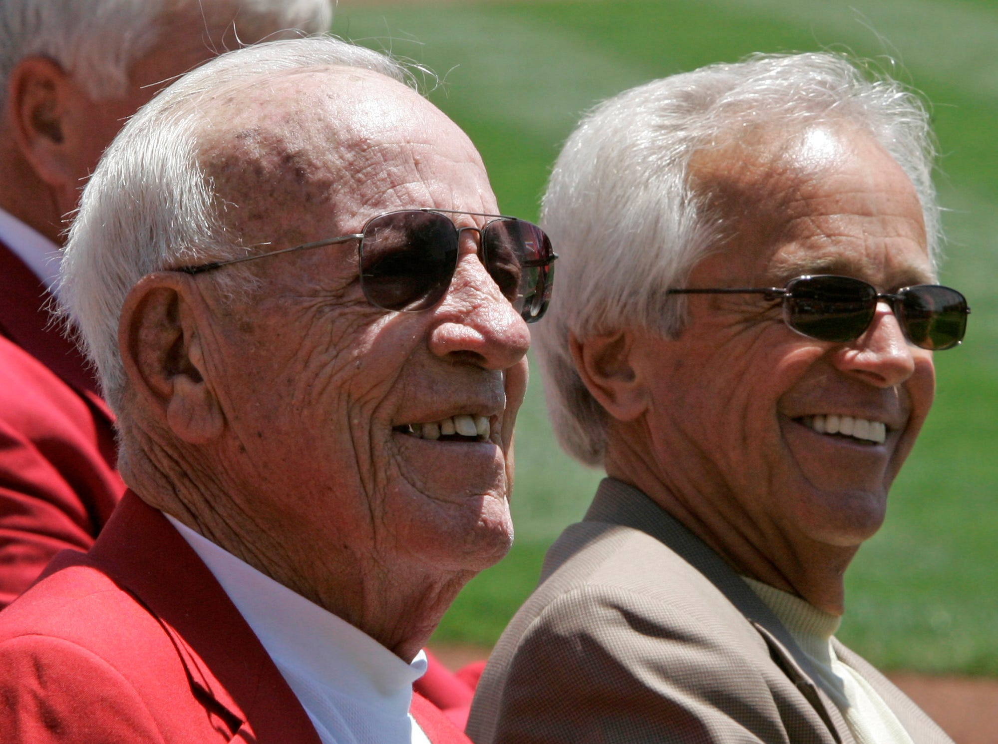 Cincinnati Reds broadcasters Joe Nuxhall, left, and Marty Brennaman smile during ceremonies honoring them and broadcaster Waite Hoyt prior a baseball game between the Reds and Cleveland Indians, Sunday, June 10, 2007, in Cincinnati.