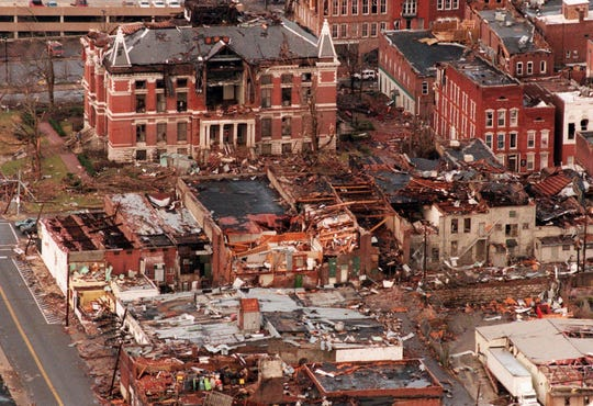 Rubble lies where it fell in downtown Clarksville on Saturday, Jan. 23, 1999, the day after a tornado damaged more than 438 buildings, including the Montgomery County Courthouse, above left.