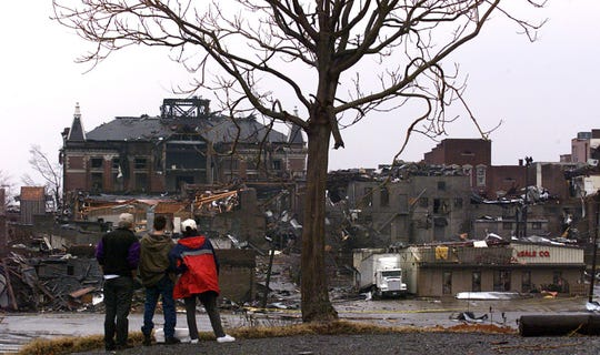 Spectators view devastation surrounding the Montgomery County Courthouse after an early morning tornado leveled parts of downtown Clarksville on Jan. 22, 1999.