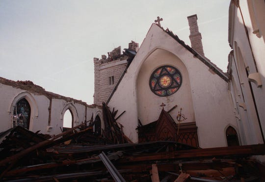 The interior of the tornado-damaged Trinity Episcopal Church on 317 Franklin St. in Clarksville, after the Jan. 22, 1999, storm. The roof can be seen draped over the pews.