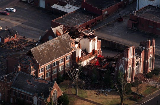 The early sun shows the gutted remains of the Madison Street United Methodist Church a day after a tornado tore through downtown Clarksville on Jan. 22, 1999.