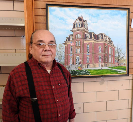 Mike Stiers has paintings, including one of the Coshocton County Courthouse, on display this month at the West Lafayette Branch Library. Stiers has dabbled in many media over his life and likes to paint local landscapes and dogs.
