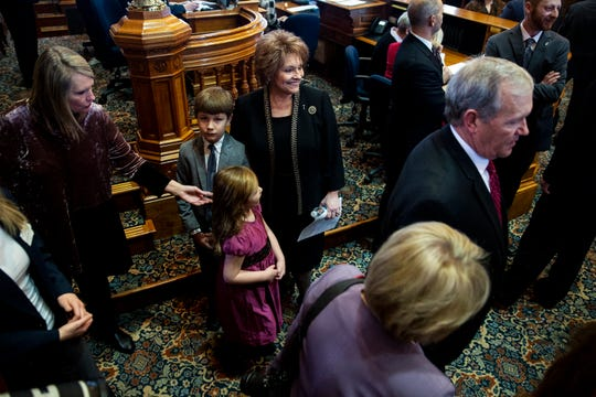 Speaker of the Iowa House Linda Upmeyer, R-Clear Lake, gathers with her grandchildren on the House floor before the start of the first day of the 2019 legislative session on Monday, Jan. 14, 2019, at the Iowa State Capitol in Des Moines.