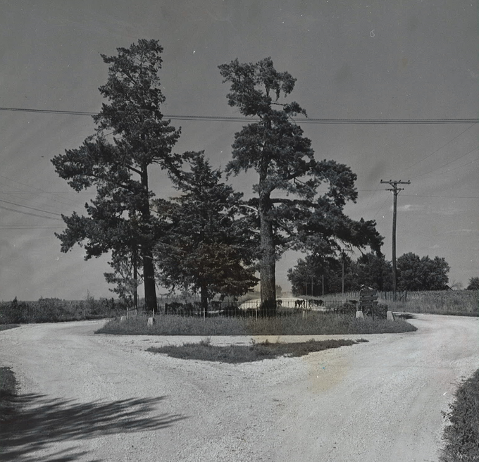 From 1962: Historic Huston Cemetery, located in the middle of the intersection of 88th Street and George Mills Parkway in Dallas County. James B. Huston was the patriarch of one of the first families to settle in Dallas County, and the grave site contains several of his family members.