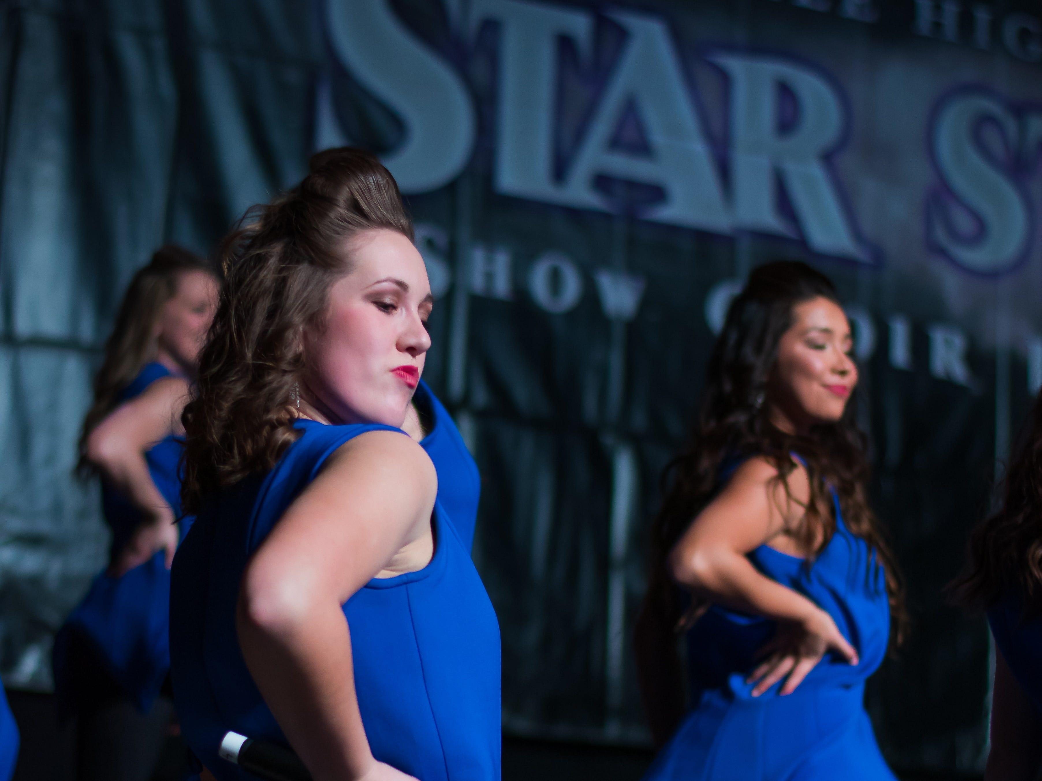 Waukee show choir group Millennium performs on Saturday, Jan. 12, 2019 at the Waukee Star Struck Show Choir Invitational in the Waukee High School Field House.