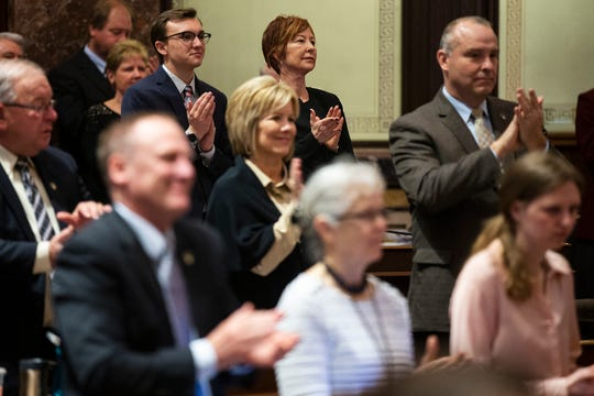 Sen. Jackie Smith, D-Sioux City, applauds from her seat in the Senate chambers on the first day of the 2019 legislative session on Monday, Jan. 14, 2019, in Des Moines.