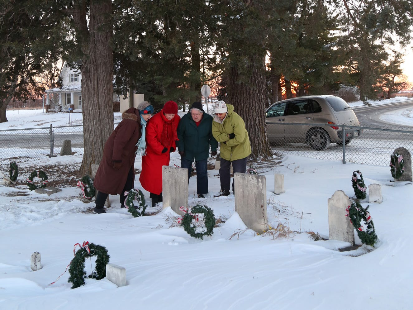 From 2013: Members of the Huston's Plot chapter of The Questers care for the tiny Huston cemetery, located in the middle of Mills Civic Parkway. Questers members from left, Sue Jones, Jane Herbold, Lola Suckow and Flo Dietz visit the cemetery.
