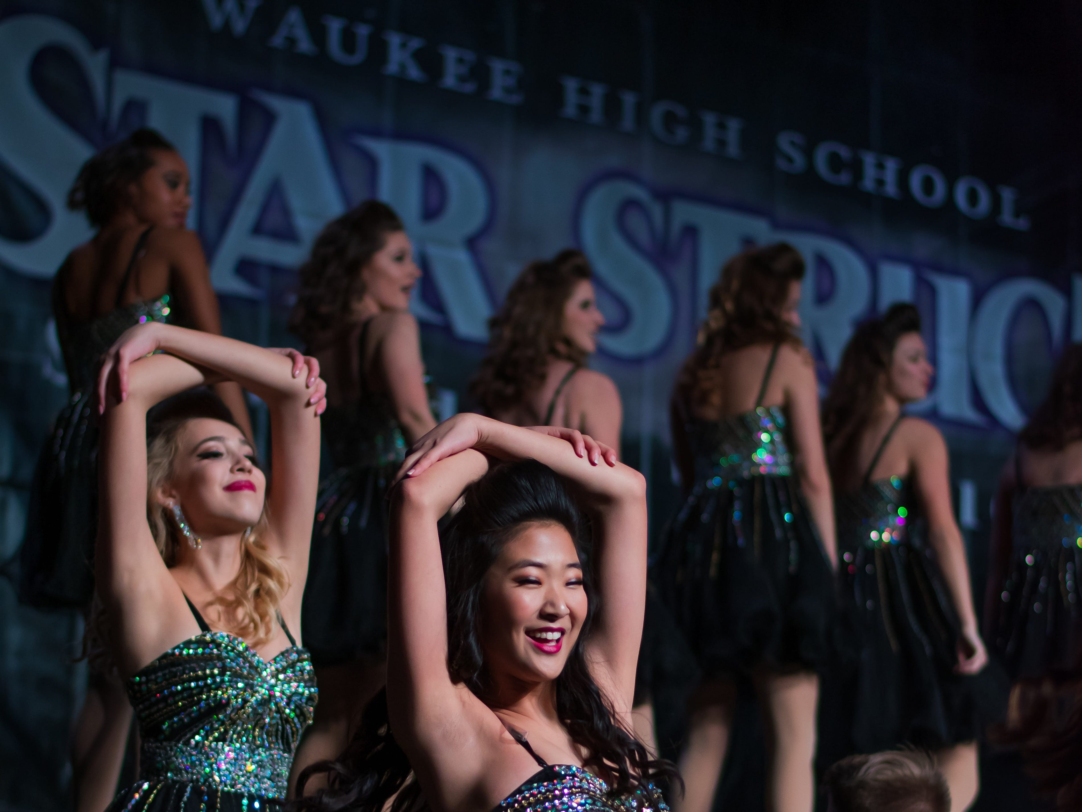 Johnston High show choir group Innovation performs on Saturday, Jan. 12, 2019 at the Waukee Star Struck Show Choir Invitational in the Waukee High School Field House.