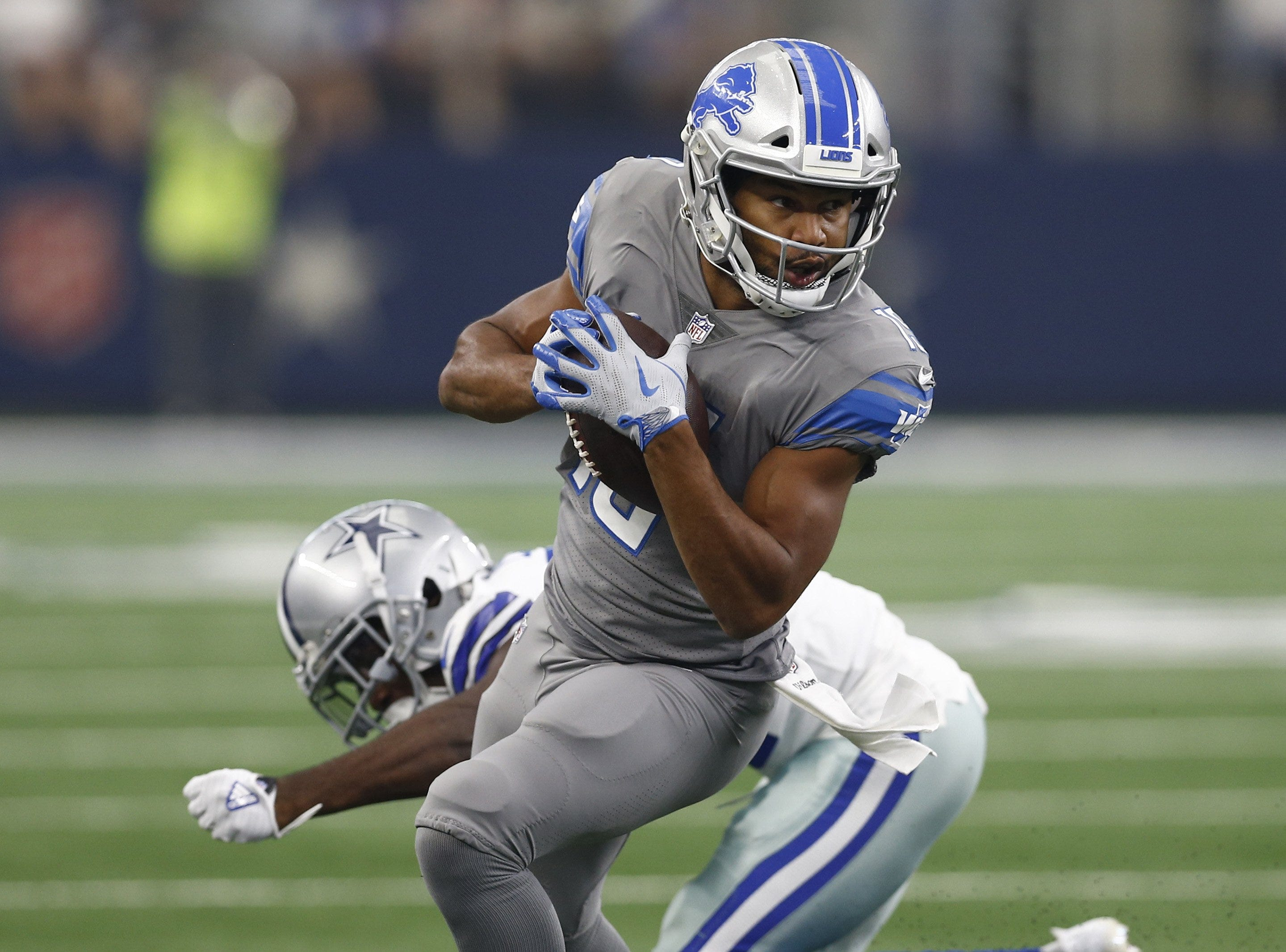Lions wide receiver Golden Tate breaks a tackle on his touchdown catch during the first half of the Lions' 26-24 loss on Sunday, Sept. 30, 2018, in Arlington, Texas.