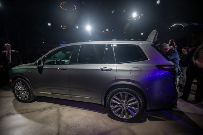 Members of the media get a close up look at the 2020 Cadillac XT6, a new three-row SUV, at the Garden Theater during the North American International Auto Show in Detroit on Sunday, Jan. 13, 2019.