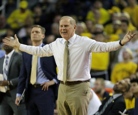Michigan coach John Beilein protests a call during the first half against Northwestern.