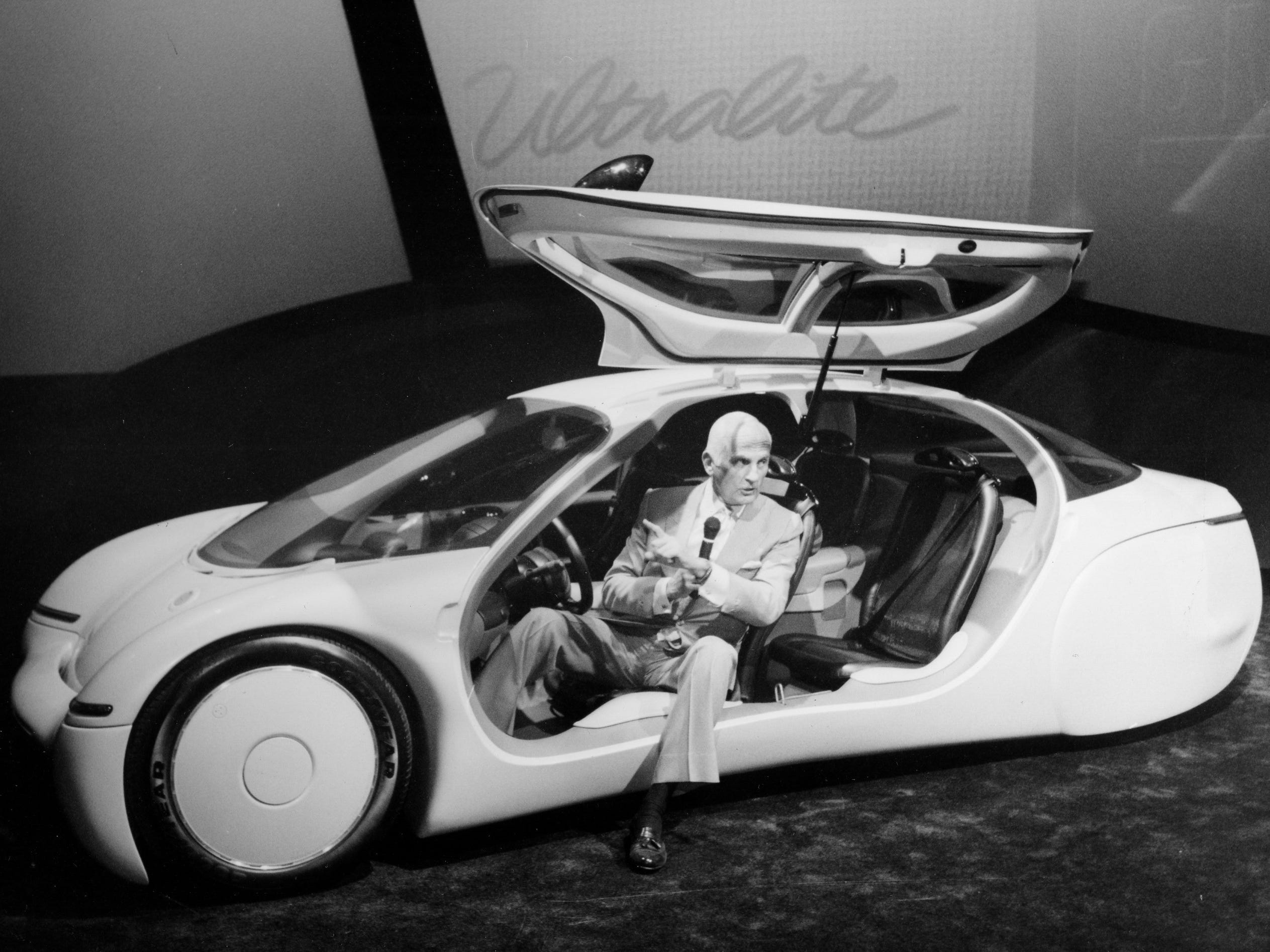Charles Jordan, GM Design staff Vice president, shows off the ultralite concept car at Cobo during the 1992 North American International Auto show held at Cobo Center.