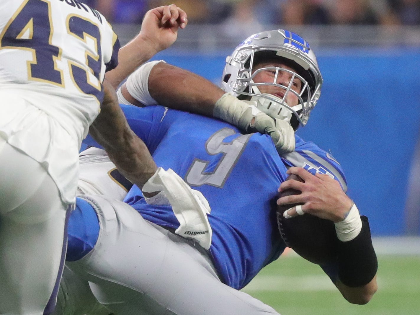 Lions quarterback Matthew Stafford is slammed to the ground by Rams defensive tackle Aaron Donald during the second half of the Lions' 30-16 loss on Sunday, Dec. 2, 2018, at Ford Field.