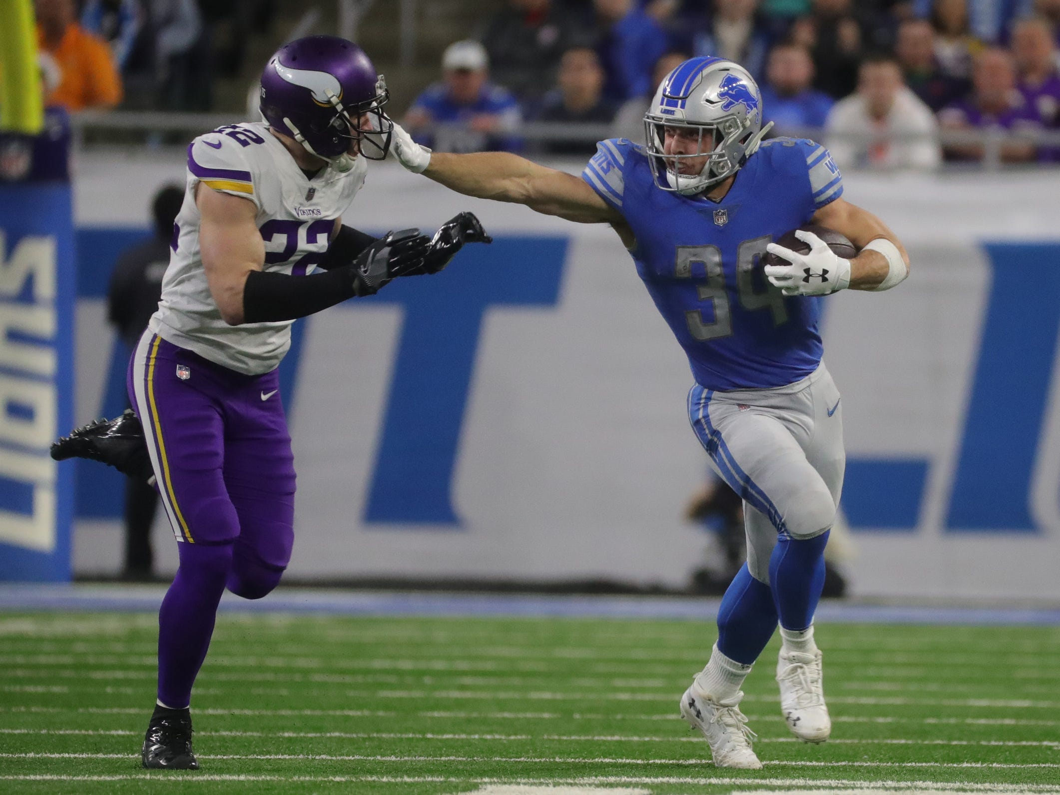 Lions running back Zach Zenner runs by Vikings safety Harrison Smith during the first half of the Lions' 27-9 loss on Sunday, Dec. 23, 2018, at Ford Field.