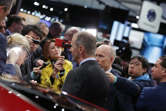 Herbert Diess, CEO of Volkswagen, talks with the press after the 2020 Volkswagen Passat was revealed at the 2019 North American International Auto Show held at Cobo Center in downtown Detroit on Monday, Jan. 14, 2019.