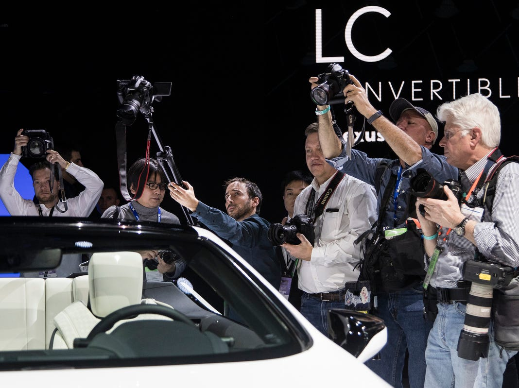 Media members take photos of the Lexus LC convertible concept during the 2019 North American International Auto Show held at Cobo Center in downtown Detroit on Monday, Jan. 14, 2019.
