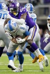 Minnesota Vikings' MacKensie Alexander sacks Detroit Lions quarterback Matthew Stafford in the third quarter on Sunday, Nov. 4, 2018, at U.S. Bank Stadium in Minneapolis, Minn.