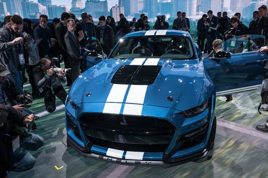 Media crowd around the all-new 2020 Mustang Shelby GT 500 during the 2019 North American International Auto Show held at Cobo Center in downtown Detroit on Monday, Jan. 14, 2019.