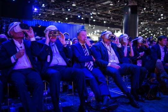 Ford Motor Co. Executive Chairman Bill Ford Jr., center, sits between executives watching a virtual reality experience before the reveal of the all-new 2020 Mustang Shelby GT 500 during the 2019 North American International Auto Show held at Cobo Center in downtown Detroit on Monday, Jan. 14, 2019.