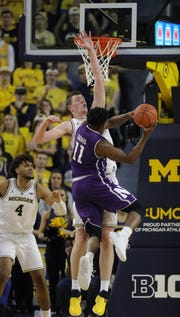 Jon Teske defends Northwestern guard Anthony Gaines during the second half.