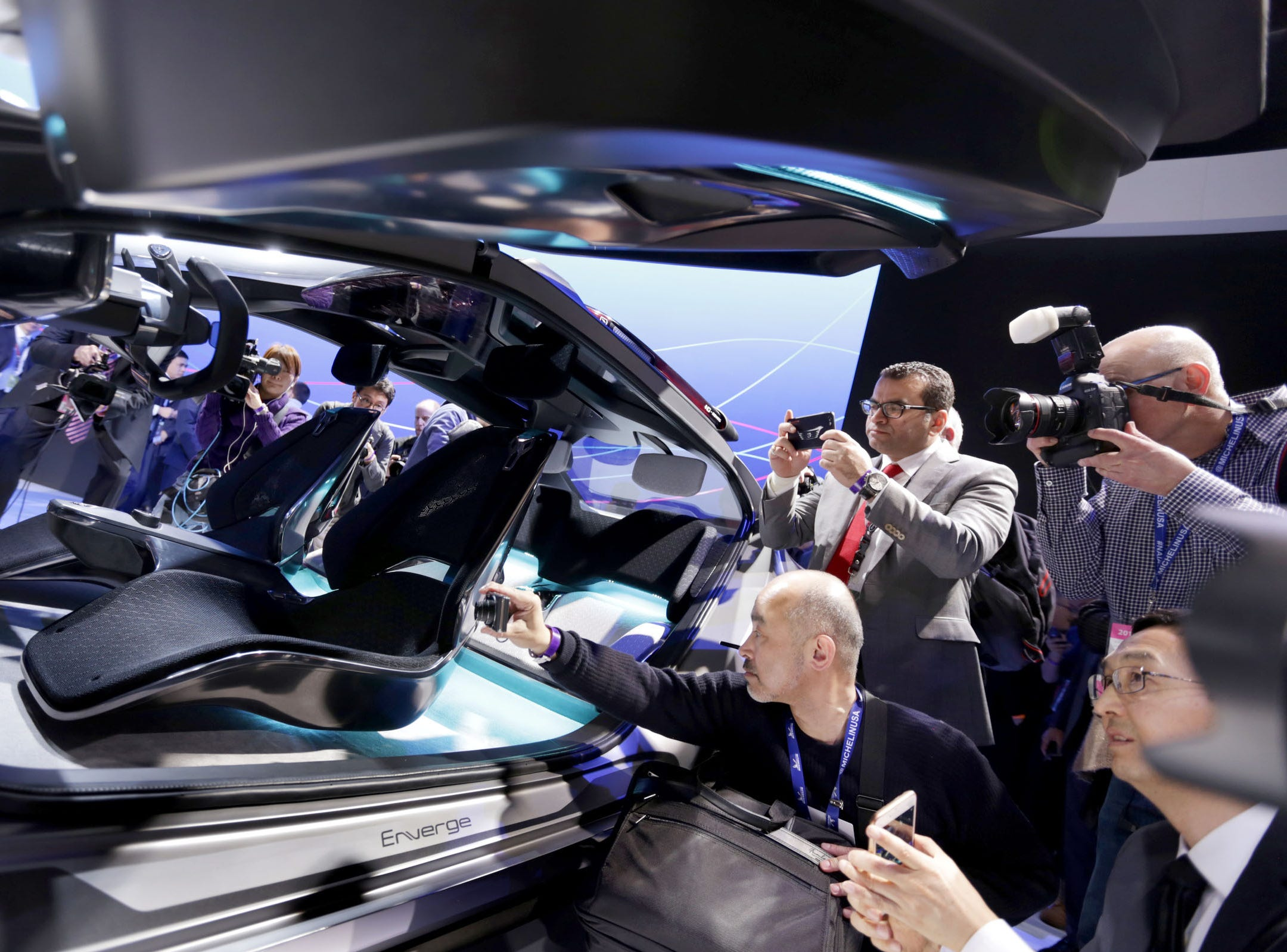 "Reporters and photographers look at the Enverge, GAC Motor""s concept car during the North American International Auto Show at Cobo Center in Detroit on Monday, January 14, 2018."