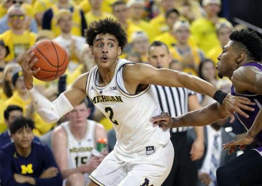 Michigan guard Jordan Poole drives against Northwestern guard Anthony Gaines during the second half Sunday, Jan. 13, 2019 at Crisler Center in Ann Arbor.
