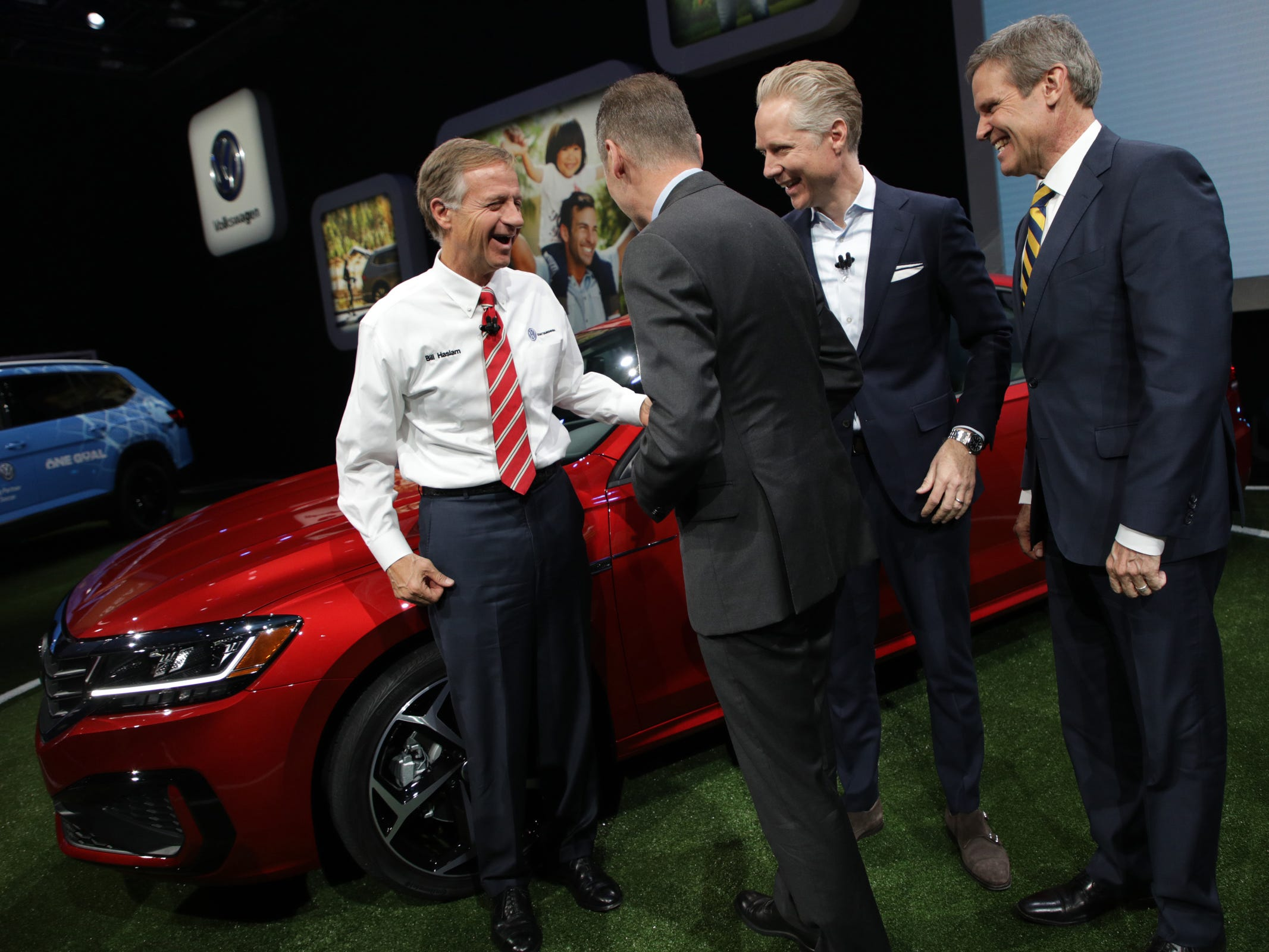 Bill Haslam, Governor of Tennessee, from left Dr. Herbert Diess, ceo of Volkswagen, Scott Keogh, ceo and president of Volkswagen Group of America and Tennessee Governor elect Bill Lee talk before posing for a photograph in front of  the 2020 Volkswagen Passat at the 2019 North American International Auto Show held at Cobo Center in downtown Detroit on Monday, Jan. 14, 2019.