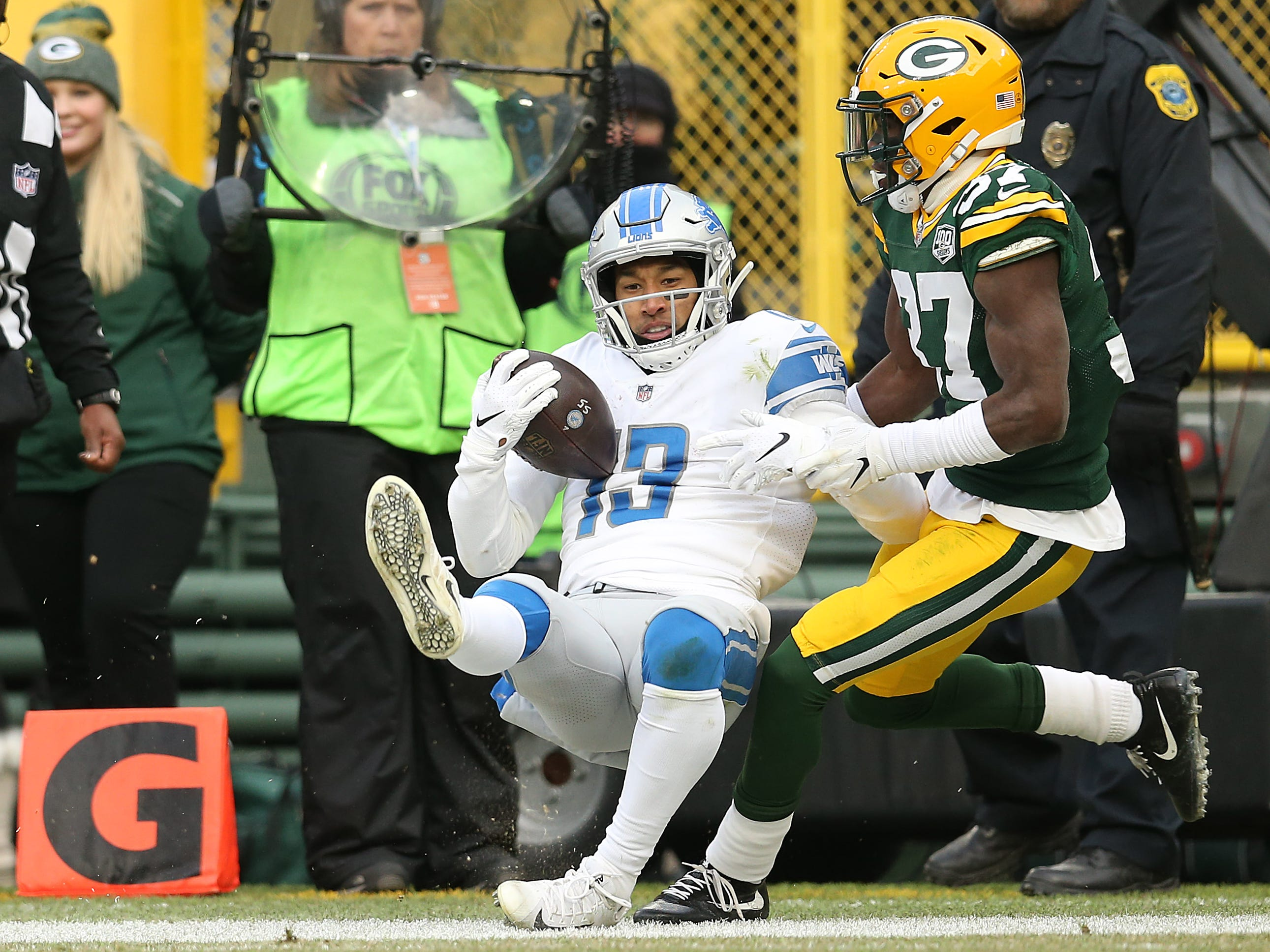 Lions wide receiver TJ Jones catches a pass for a touchdown against the Packers' Josh Jackson during the second half of the Lions' 31-0 win on Sunday, Dec. 30, 2018, in Green Bay, Wis.