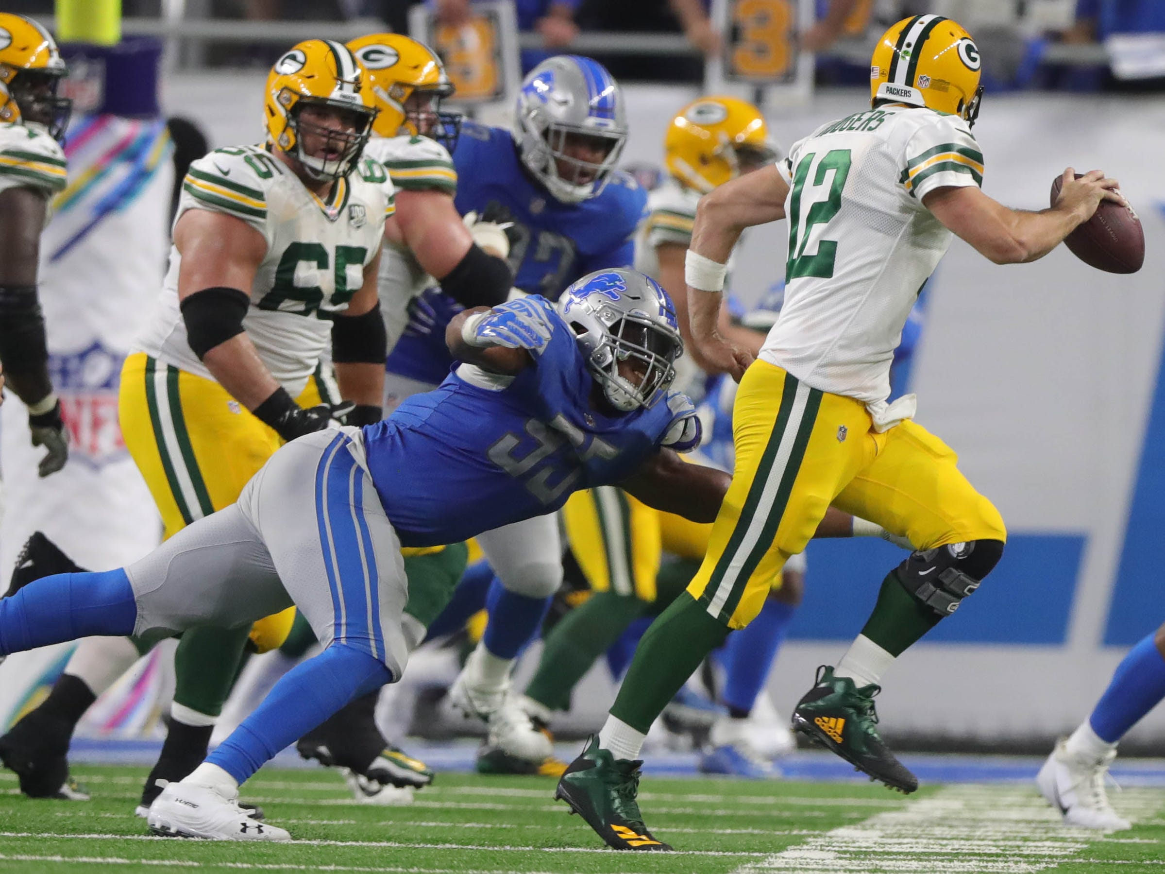 Lions linebacker Eric Lee puts pressure on Packers quarterback Aaron Rogers during the first half of the Lions'  31-23 win on Sunday, Oct. 7, 2018, at Ford Field.