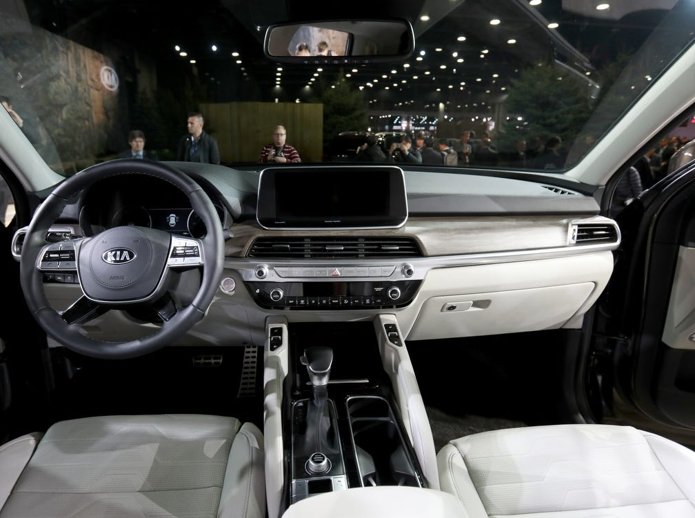 The interior showing the driver and passenger seating and dashboard of the 2019 Kia Telluride. The sport utility was shown off to the automative press during the start of the North American International Auto Show media previews at Cobo Center in Detroit on Monday, January, 14, 2019.