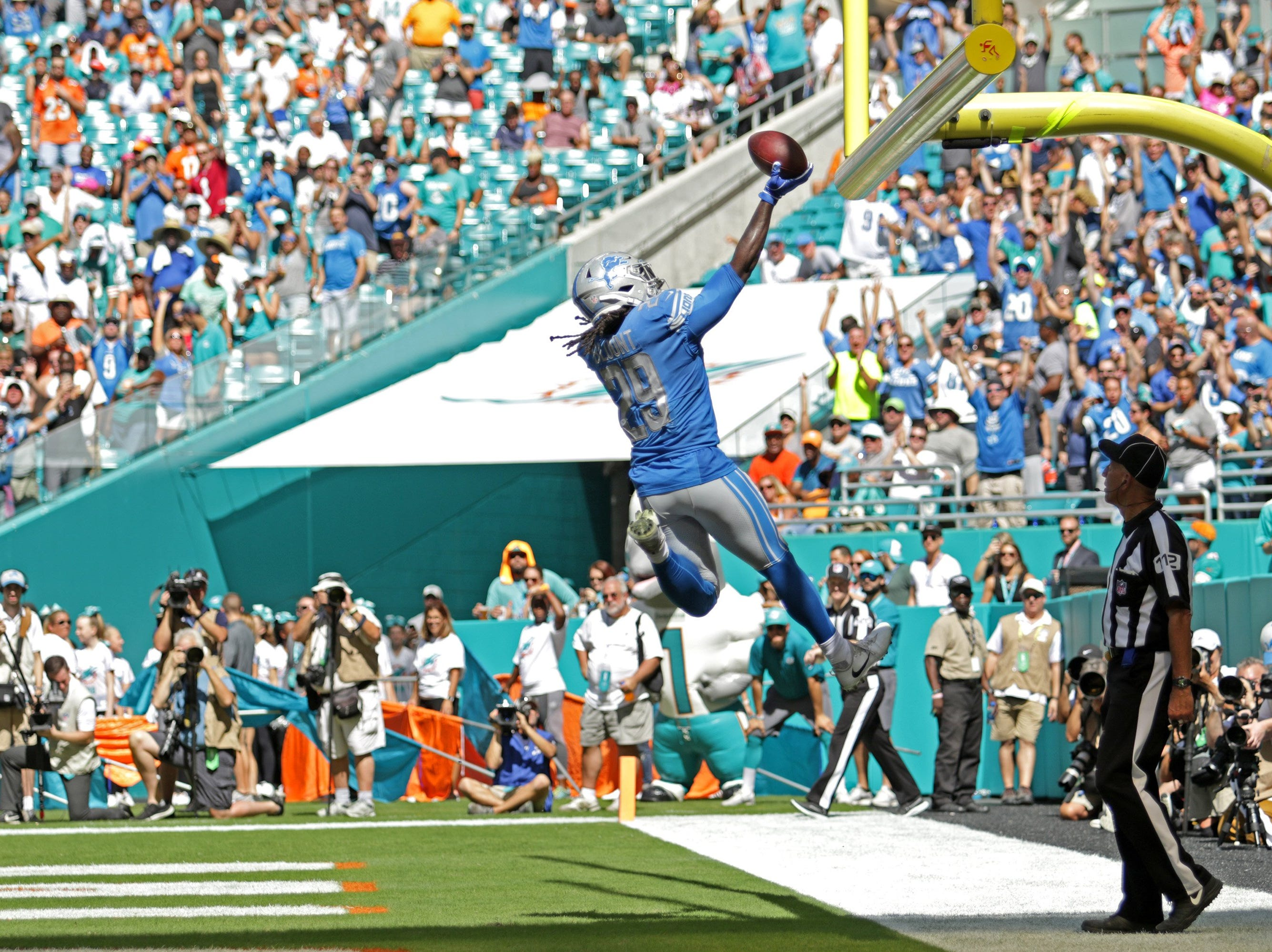 Lions running back LeGarrette Blount celebrates a touchdown in the second quarter of the Lions' 32-21 win on Sunday, Oct. 21, 2018, in Miami Gardens, Fla.