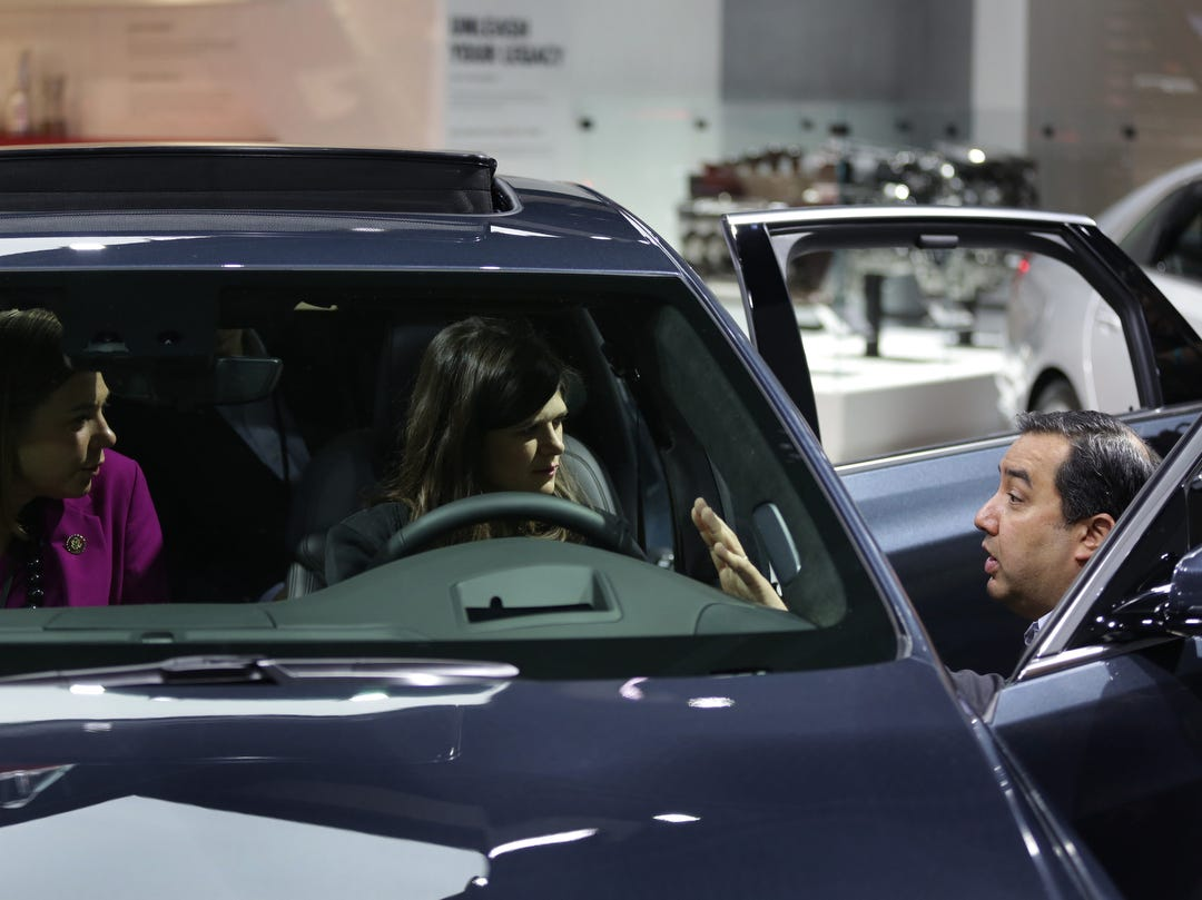 Michigan Representatives Elissa Slotkin, from left and Haley Stevens talk with Richard Lopez of General Motors while sitting in the Cadillac CT6 3.0TT during a tour of the 2019 North American International Auto Show held at Cobo Center in downtown Detroit on Monday, Jan. 14, 2019.