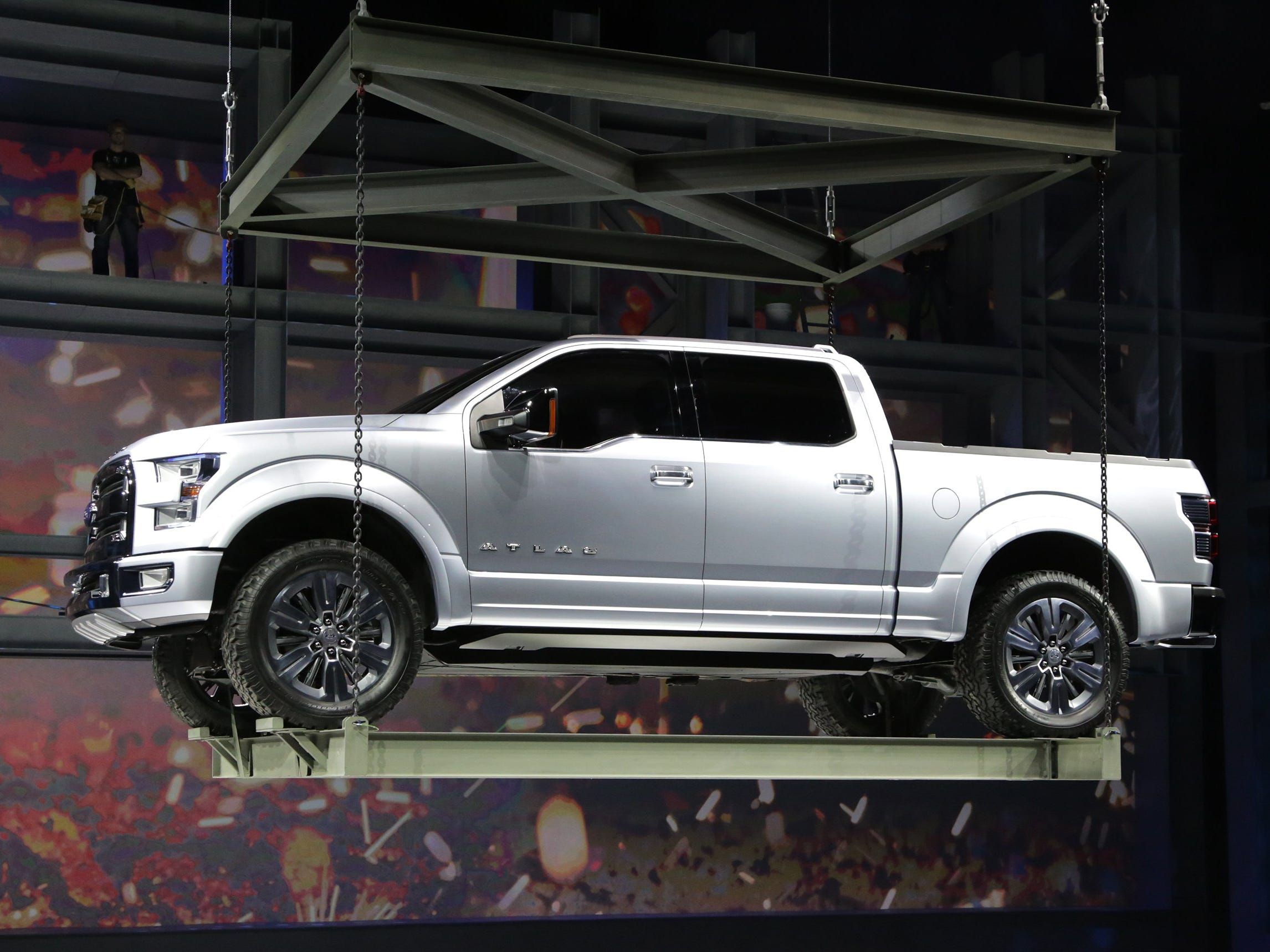 The Ford Atlas concept truck is lowered during it's unveiling at Joe Louis Arena during the 2013 North American International Auto Show on Tuesday, Jan. 15, 2013 in Detroit.