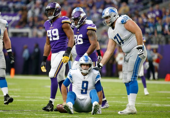 Lions quarterback Matthew Stafford sits on the field next to offensive lineman Rick Wagner after getting sacked by Vikings defensive end Danielle Hunter (99) during the first half of the Lions' 24-9 loss Sunday, Nov. 4, 2018, in Minneapolis.