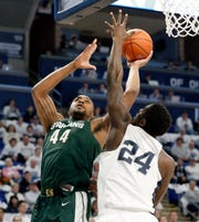 Michigan State's Nick Ward shoots over Penn State's Mike Watkins during the first half in State College, Pa. Sunday, Jan. 13, 2019.