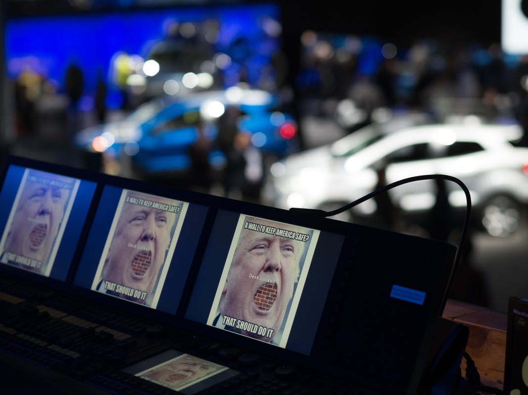 A photo of President Donald Trump is seen on screens for video team at the Ford display during the 2019 North American International Auto Show held at Cobo Center in downtown Detroit on Monday, Jan. 14, 2019.