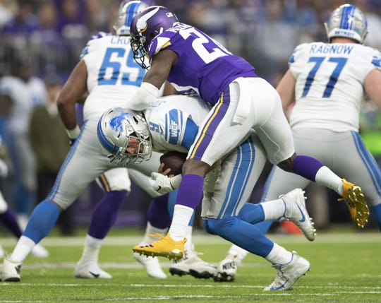 Minnesota Vikings' Mackensie Alexander sacks Detroit Lions quarterback Matthew Stafford for a six yard loss in the third quarter on Sunday, Nov. 4, 2018 at U.S. Bank Stadium in Minneapolis, Minn. (Jerry Holt/Minneapolis Star Tribune/TNS)