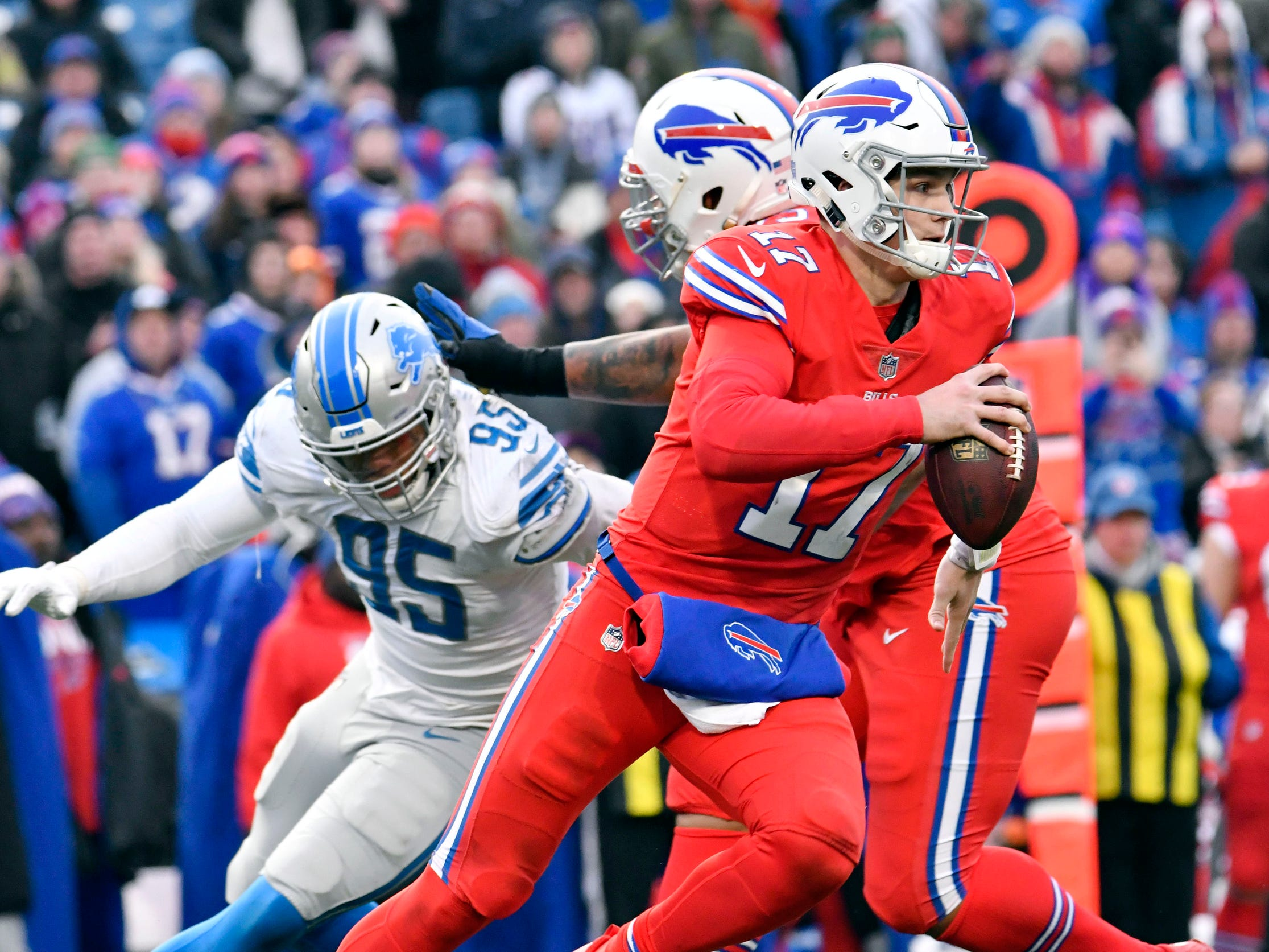 Bills quarterback Josh Allen runs out of the pocket as Lions defensive end Romeo Okwara applies pressure in the fourth quarter of the Lions' 14-13 loss on Sunday, Dec. 16, 2018, in Orchard Park, N.Y.