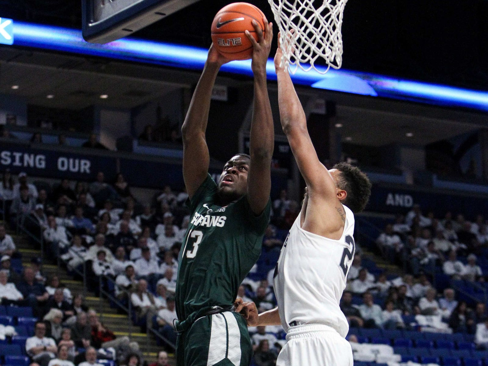 Michigan State forward Gabe Brown drives to the basket as Penn State guard Josh Reaves defends in the second half in State College, Pa., Sunday, Jan. 13, 2019.