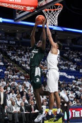 Michigan State's Gabe Brown drives to the basket as Penn State's Josh Reaves defends in the second half in State College, Pa., on Sunday.