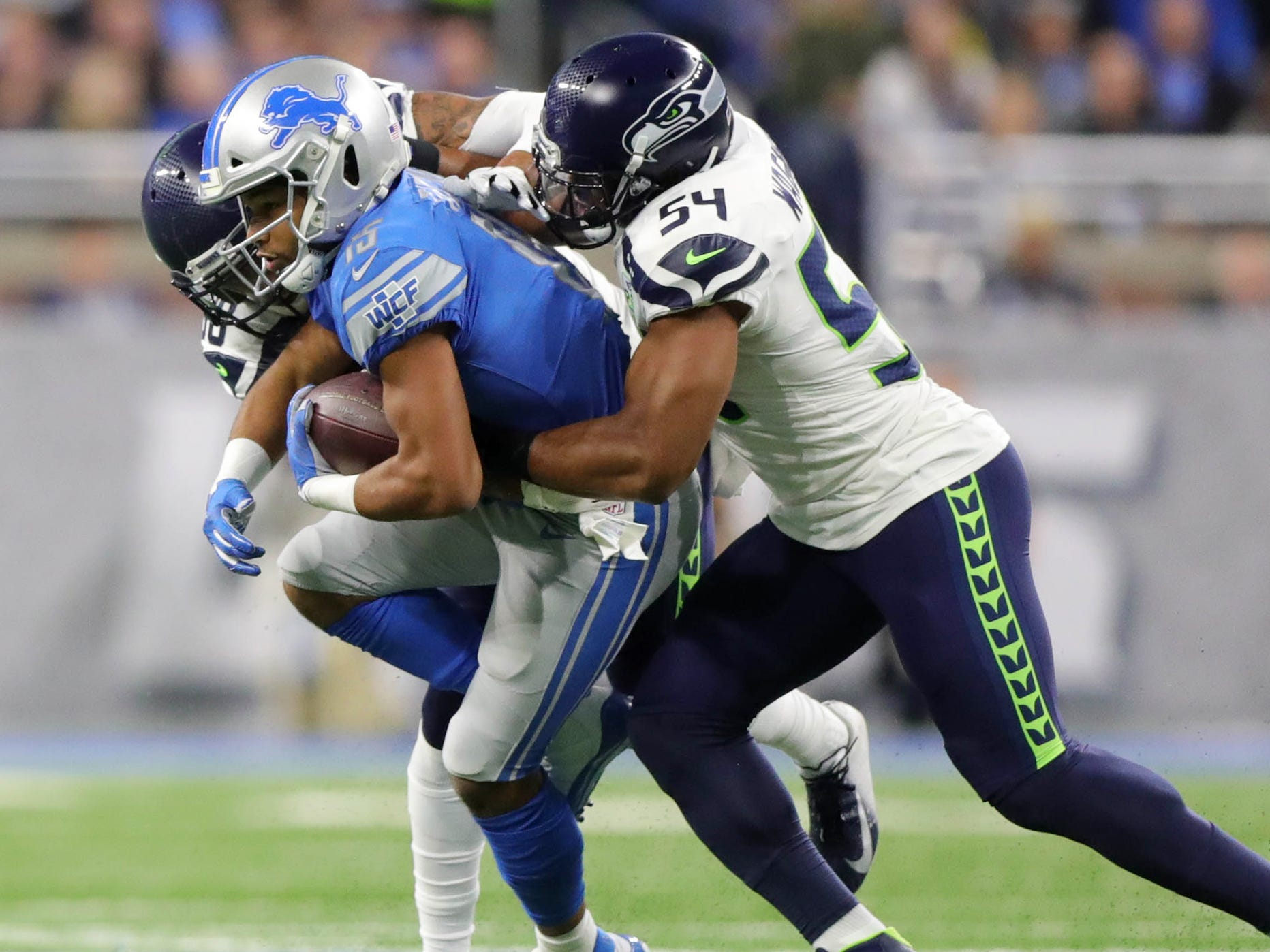 Lions receiver Golden Tate is tackled by Seahawks defenders Bradley McDougald and Bobby Wagner (54) during the first half of the Lions' 28-14 loss on Sunday, Oct. 28, 2018, at Ford Field.