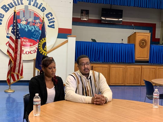 Dominique Moore (left) and her husband Bryan Moore, of Troy. The two say they are in limbo after the announcement of the GM Detroit-Hamtramck plant closure, as workers await either a transfer or a layoff.