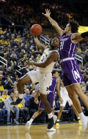 Zavier Simpson scores against Northwestern during the first half Sunday.