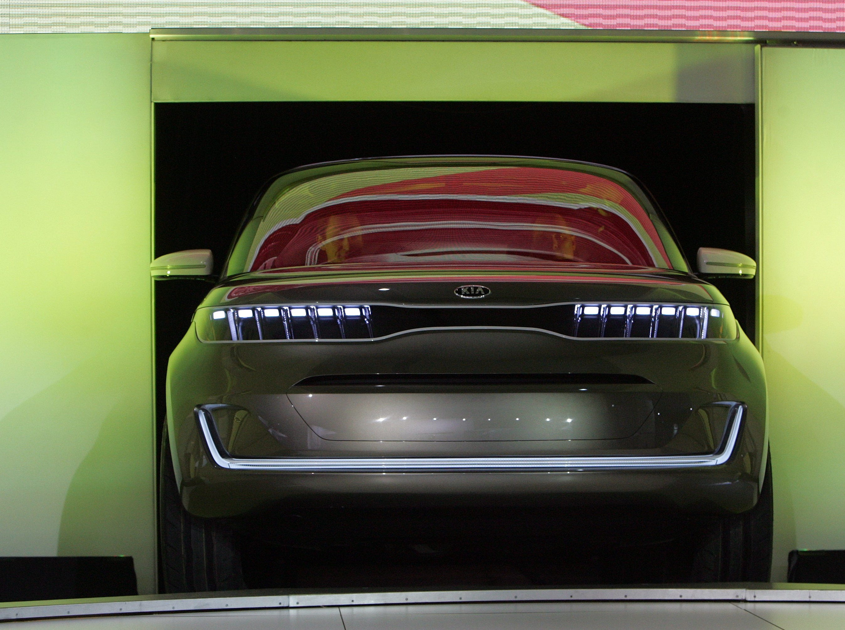 The KIA van concept called the KV7 is driven out onto a platform for the media during the KIA press conference at Cobo Arena at the 2011 North American International Auto Show held at Cobo Center.