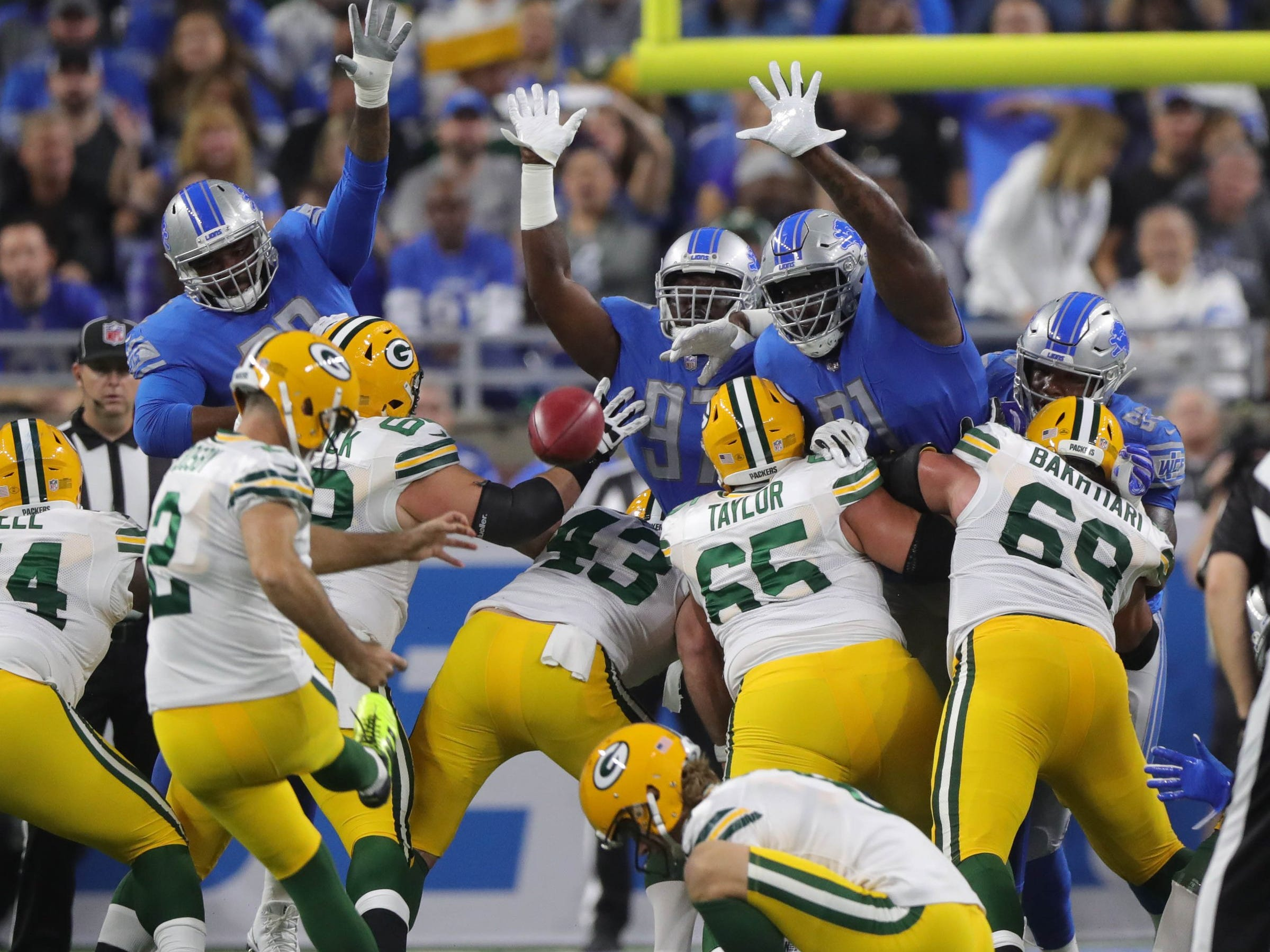 The Lions' defense tries to block a field goal by Packers kicker Mason Crosby, who missed, during the first half of the Lions' 31-23 win on Sunday, Oct. 7, 2018, at Ford Field.