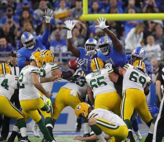 The Lions try to block a field goal by Packers kicker Mason Crosby, who missed, during the first half of the Lions' 31-23 win Oct. 7, 2018.