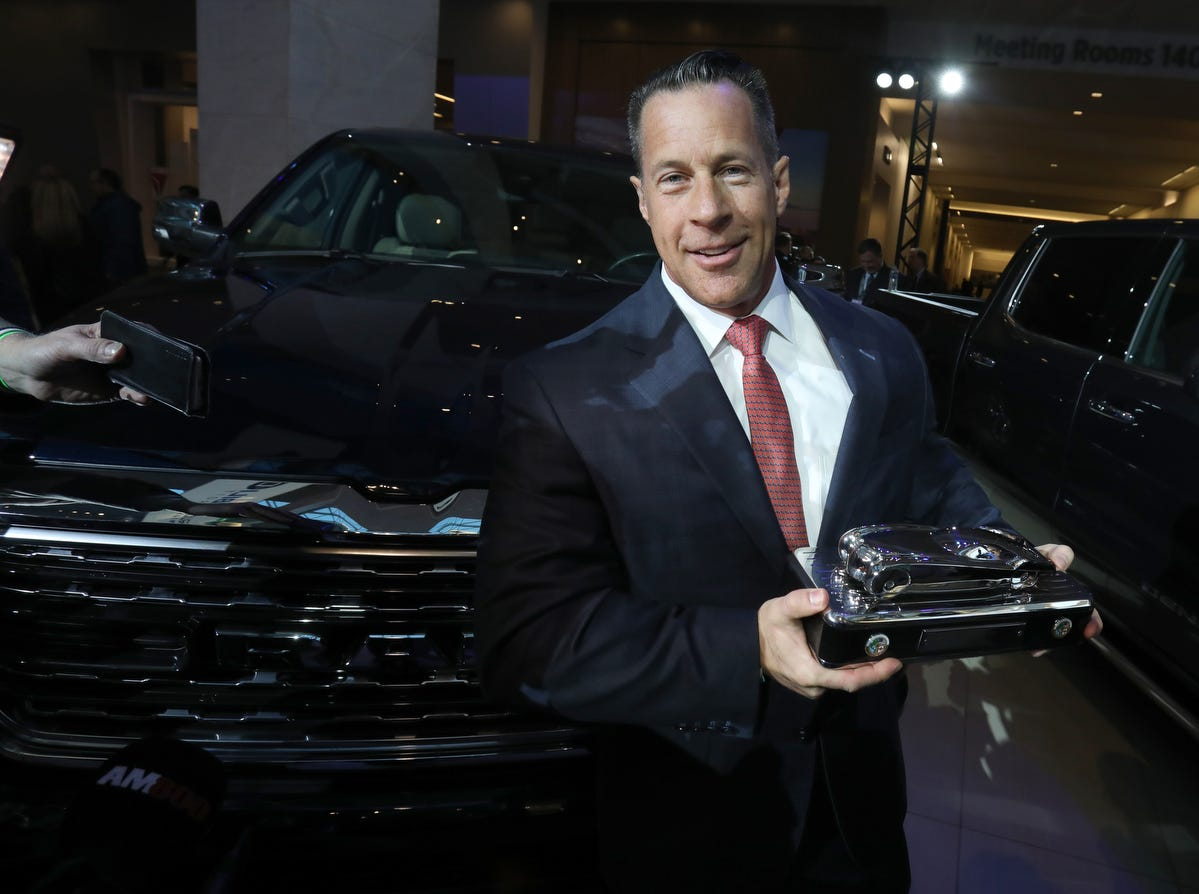 Reid Bigland, head of Ram brand, poses with trophy for the North American Truck of the Year for the Ram 1500 at the start of the North American International Auto Show media previews at Cobo Center in Detroit on Monday, January, 14, 2019.