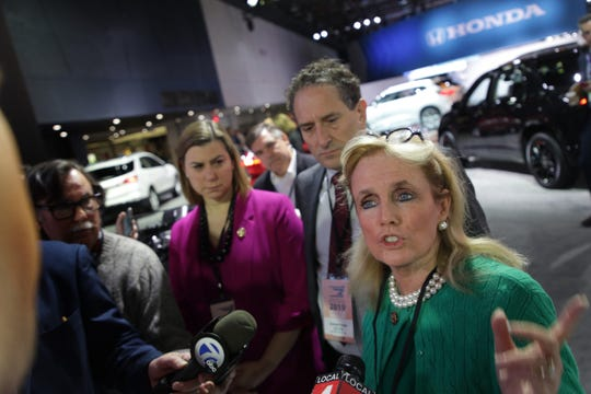 Michigan Representatives Debbie Dingell, from right Andy Levin, and Elissa Slotkin talk to the media during a tour of the 2019 North American International Auto Show held at Cobo Center in downtown Detroit on Monday, Jan. 14, 2019.