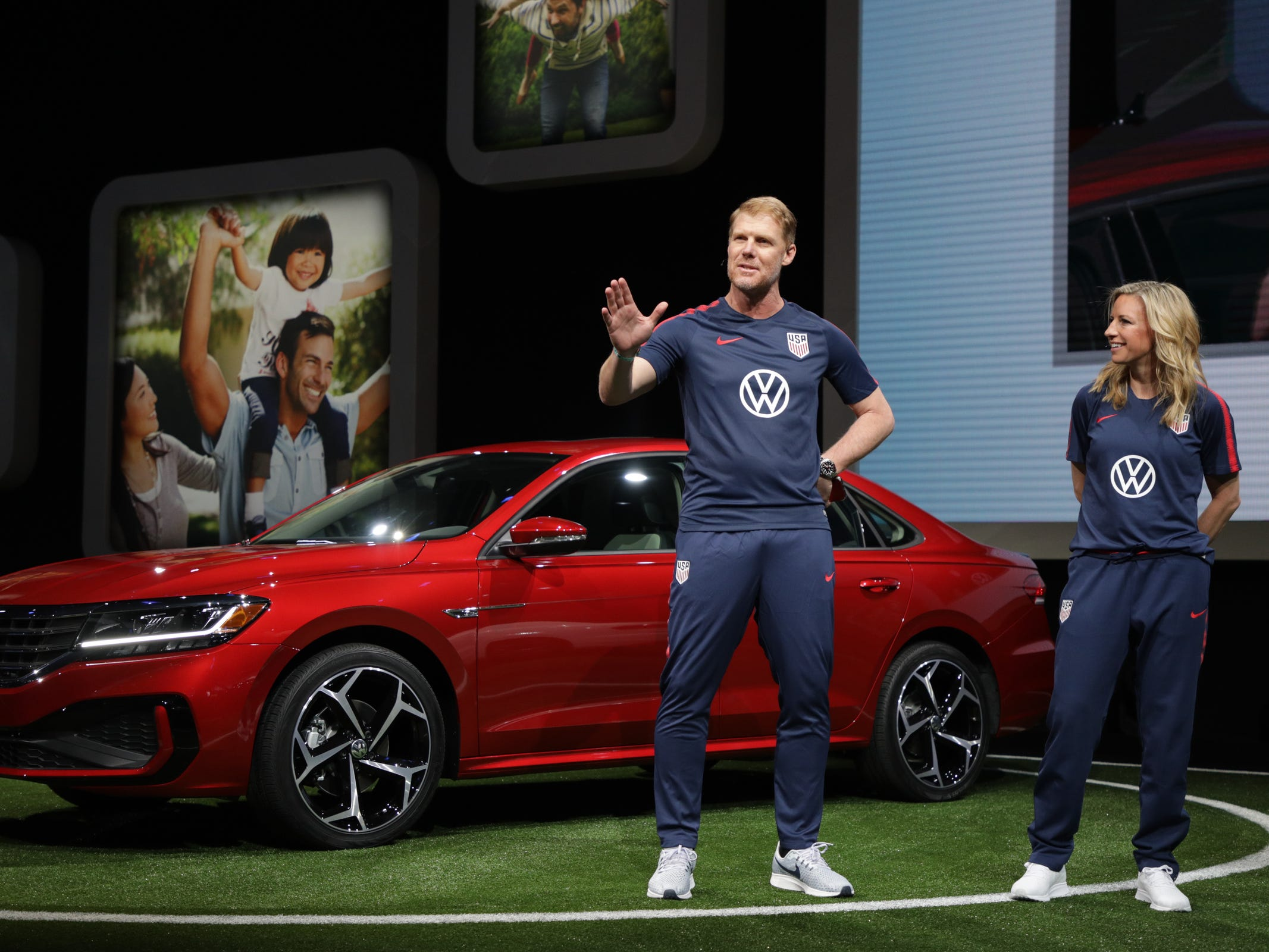 Alexi Lalas, left and Aly Wagner talk about the new partnership of U.S. Soccer and Volkswagen America after the 2020 Volkswagen Passat is revealed at the 2019 North American International Auto Show held at Cobo Center in downtown Detroit on Monday, Jan. 14, 2019.