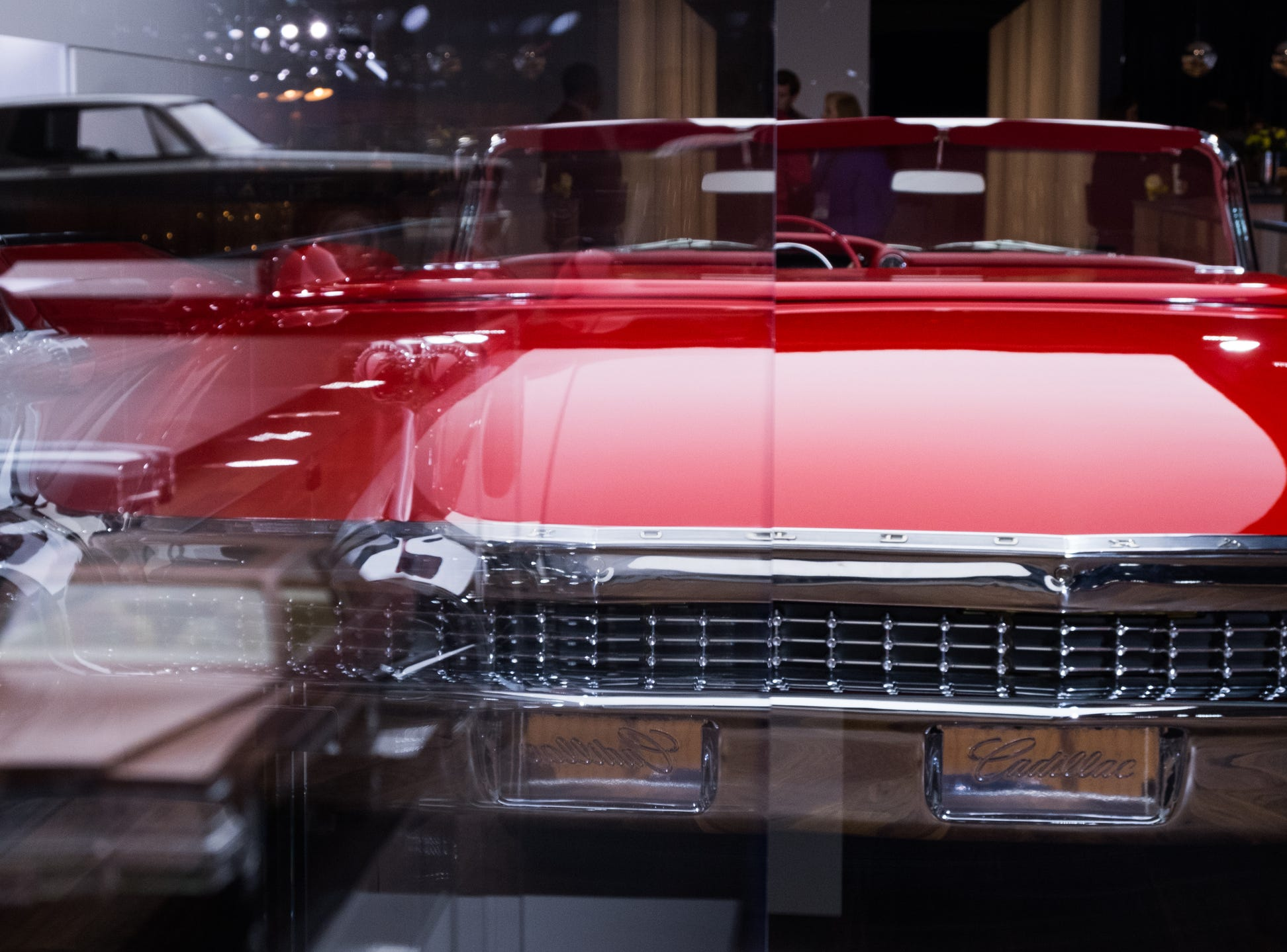 Models of Cadillac cars are on display near a 1959 Cadillac Eldorado Biarritz Convertible during the 2019 North American International Auto Show held at Cobo Center in downtown Detroit on Monday, Jan. 14, 2019.